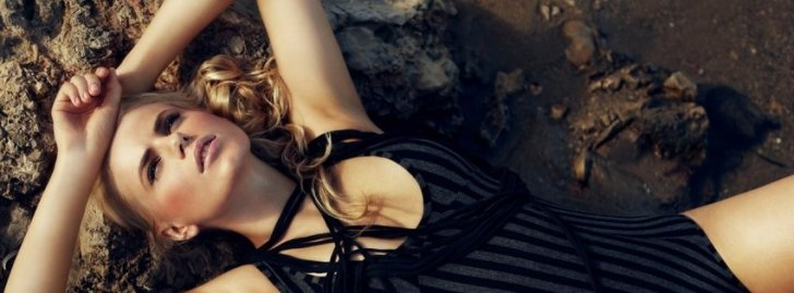 Beautiful Blond Girl On The Beach